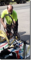 Doug Burton changing wheels on the Yellow Bike