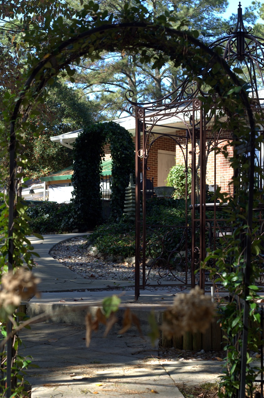 Looking from the East Garden through the Jasmine Gateway at the Ivy Gateway
