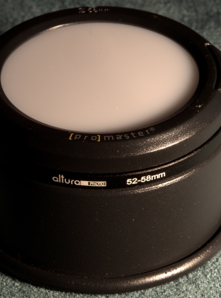 Promaster SystemPRO White Balance Lens Cap to further diffuse light from the strobe