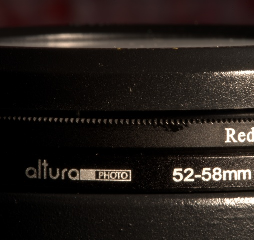 From bottom-to-top: Snoot, Step-Up ring adapter, color lens, & lens cap