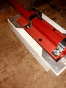 Carport attic: 2x4 box to frame the hoist. the red bar rest on 2 ceiling joist