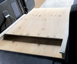 "Tray, with 9 2"" ridged casters on the bottom"