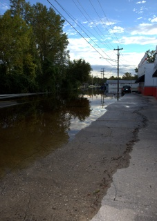 Dunn Road, between Person and Grove Streets [looking south towards Person Street] The water has receeded some here.